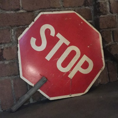 handheld STOP SLOW sign